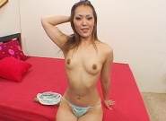 Asian-slut-sucks-the-head-of-a-big-dick-while-fondling...